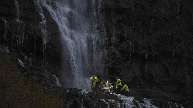 In this photo taken on Tuesday, Sept. 30, 2014, emergency personnel remove the body of Camille Stepan, 39, from, North Salt Lake, Utah,  after her body was found by a hiker at Bridal Veil Falls in Provo, Utah. Deputies say Stepan suffered serious injuries consistent with a fall from great height. (AP Photo/The Daily Herald, Sammy Jo Hester) MANDATORY CREDIT