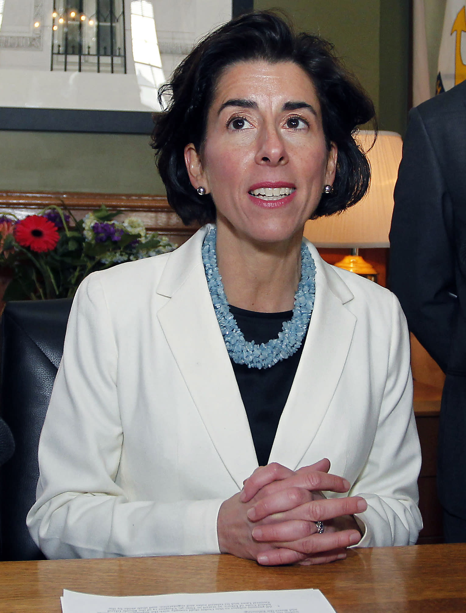 Rhode Island governor focused on economy in 1st 100 days
