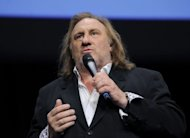 "French actor Gerard Depardieu speaks during the third edition of the Lumiere film festival in the French city of Lyon on October 8, 2011. Depardieu said on Thursday he would play the ""arrogant, smug"" former IMF chief Dominique Strauss-Kahn in a film about his fall from grace in a series of sex scandals"