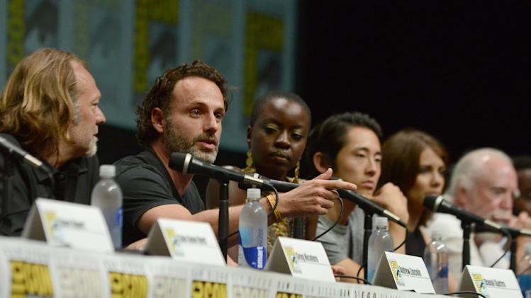 "The cast and crew of ""The Walking Dead "" participates in a panel on Day 3 of Comic-Con International on Friday, July 19, 2103, in San Diego. (Photo by Jordan Strauss/Invision/AP)"
