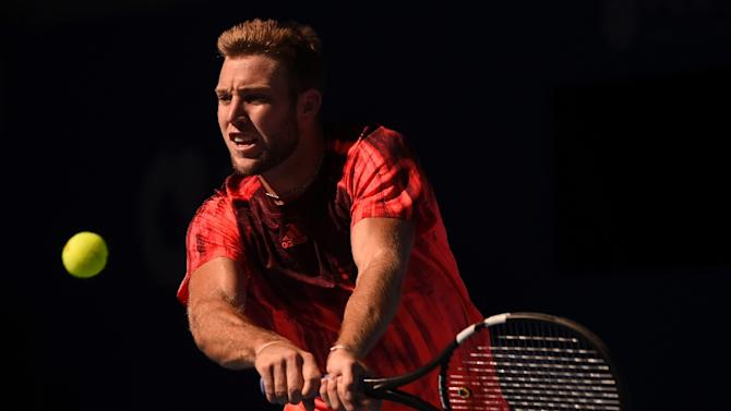 Jack Sock in action at Rafael Nadal during their men's singles quarter-final match at the China Open in Beijing on October 9, 2015