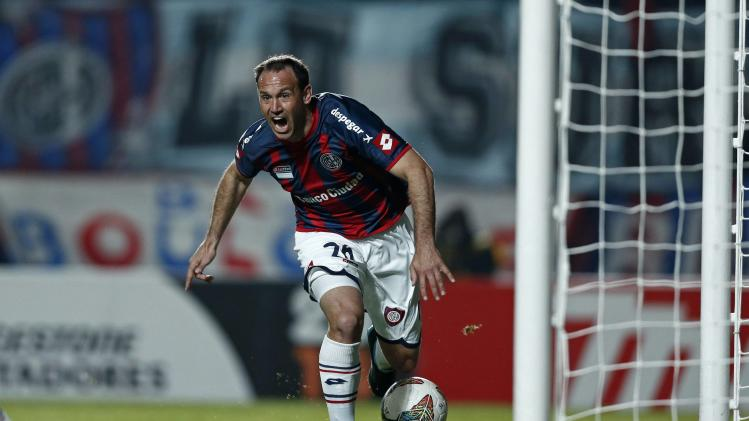 Mauro Matos of San Lorenzo celebrates scoring goal against Bolivar in Copa Libertadores semi-final in Buenos Aires