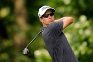 Australia&#39;s Adam Scott hits his tee shot on the 14th hole during the final round of the AT&T National on July 1. Scott finished in third place at five-under-par 279. He matched the low round of the day with a four-under par 67