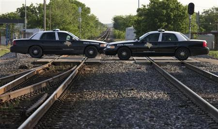 Texas State Troopers block a railway line leading towards a fertilizer plant explosion in the town of West, near Waco, Texas