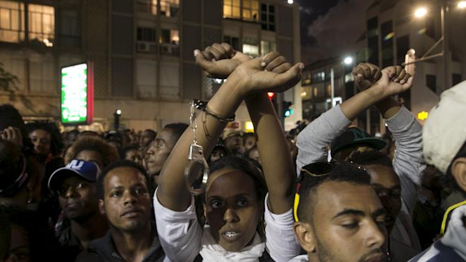 Protesters, whom are mainly Israeli Jews of Ethiopian origin, take part in a demonstration against what they say is police racism and brutality