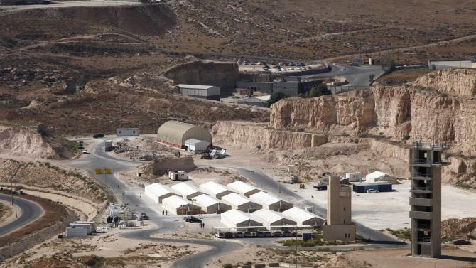 FILE - In this Thursday, Oct. 11, 2012 file photo, a general view of hangars at a desert military training facility where U.S. forces _ and a handful of British allies _ are training Jordanian commandos in Russeifeh, Jordan, Thursday, Oct. 11, 2012. The U.S. and regional allies are closely monitoring Syria's chemical weapons but seem to have few good options other for securing the toxic agents stuffed into shells, bombs and missiles that have been caught in the midst of a raging civil war. (AP Photo/Mohammad Hannon, File)