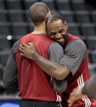 Miami Heat's LeBron James, right, hugs teammate Shane Battier during basketball practice Wednesday, June 13, 2012, in Oklahoma City. Game 2 of the NBA finals between the Heat and the Oklahoma City Thunder is Thursday. (AP Photo/Sue Ogrocki)