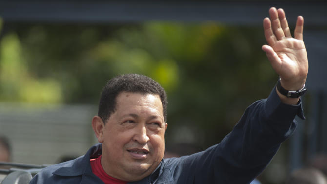 Venezuela's President Hugo Chavez waves as he leaves a polling station after voting in the presidential election in Caracas, Venezuela, Sunday, Oct. 7, 2012.  Chavez is running for re-election against opposition candidate Henrique Capriles. (AP Photo/Sharon Steinmann)