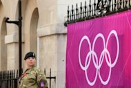 "<p>A soldier stands near an Olympic banner in London on July 25. British Prime Minister David Cameron said Thursday on the eve of the opening of the London Olympics that his top priority for the Games is their safety and security. ""The biggest concern has always got to be a safe and secure Games,"" Cameron told a press conference at the Olympic Park in London. ""That matters more than anything else.""</p>"