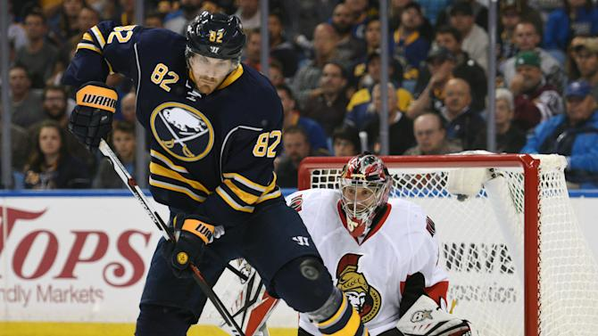 Buffalo Sabres left winger Marcus Foligno (82) tries to deflect the puck as Ottawa Senators goaltender Craig Anderson, right, reacts during the third period of an NHL hockey game, Thursday, Oct. 8, 2015 in Buffalo, N.Y. Ottawa won 3-1. (AP Photo/Gary Wiepert)