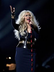 "FILE - In this Oct. 8, 2011 file photo, singer Christina Aguilera performs at the Michael Forever the Tribute Concert, at the Millennium Stadium in Cardiff, Wales. Aguilera and actress Scarlett Johansson are among the many celebrities whose racy ""private"" photos have been hacked and posted to the Internet. (AP Photo/Joel Ryan, file)"