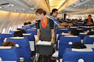 A transsexual fight attendant works onboard a Thai PC Air flight between Bangkok and Hong Kong. Months after taking to the skies with Thailand&#39;s first transsexual air crew, fledgling carrier PC Air has suspended services over financial troubles that left passengers stranded in South Korea