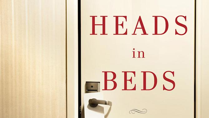 """This book cover image released by Doubleday shows """"Heads in Beds: A Reckless Memoir of Hotels, Hustles, and So-Called Hospitality. (AP Photo/Doubleday)"""