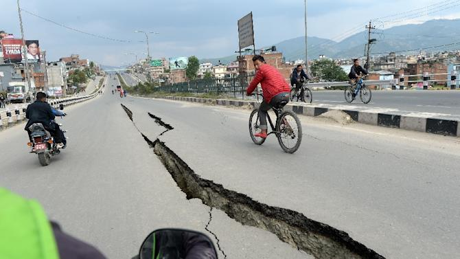 Damaged roads are seen after an earthquake on the outskirts of Kathmandu on April 26, 2015