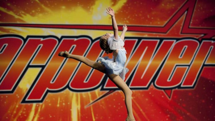 "Maddie leaps across stage in ""Dance Moms."""