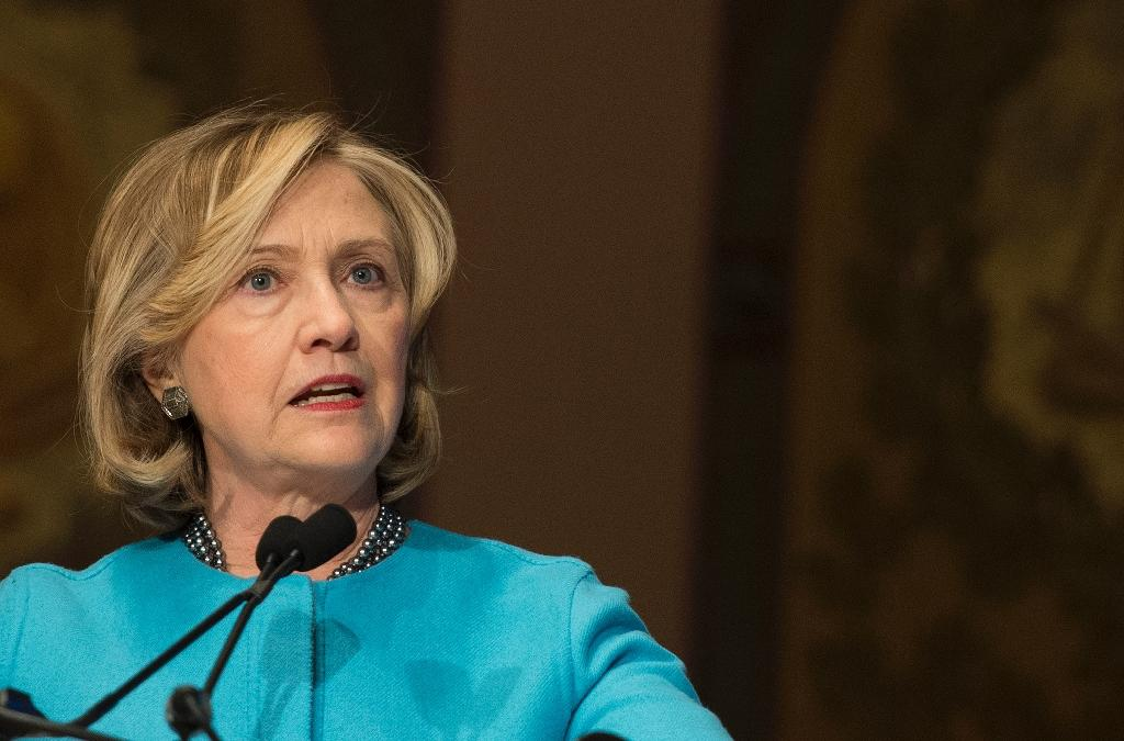 Facing storm, Clinton calls for release of her emails