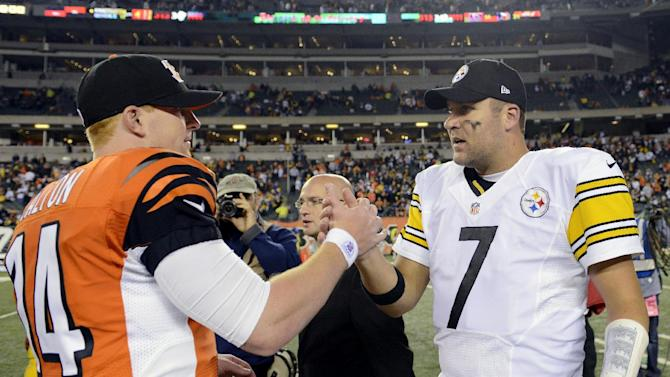 Cincinnati Bengals quarterback Andy Dalton (14) meets with Pittsburgh Steelers quarterback Ben Roethlisberger (7) after the Steelers defeated the Bengals 24-17 during an NFL football game, Sunday, Oct. 21, 2012, in Cincinnati. (AP Photo/Michael Keating)
