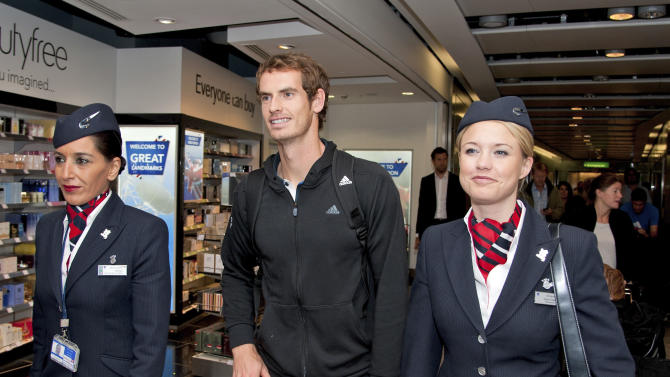 US Open tennis winner Andy Murray, centre, arrives back at Terminal 5 Heathrow Airport, London, Wednesday Sept. 12, 2012.  Murray claimed a thrilling five-set victory against Novak Djokovic in New York to become Britain's first major winner in 76-years. (AP Photo) UNITED KINGDOM OUT - NO SALES - NO MAGS