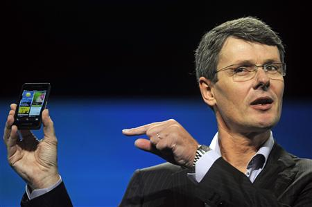 RIM CEO Heins holds up a prototype of the BlackBerry 10 smartphone at the Blackberry World event in Orlando