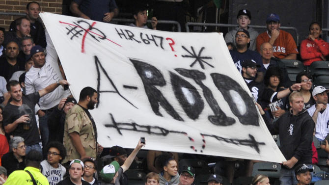 Fans holds a sign made for New York Yankees' Alex Rodriguez during the first inning of a baseball game between Yankees and the Chicago White Sox in Chicago, Monday, Aug. 5, 2013. Rodriguez was suspended through 2014 when Major League Baseball disciplined 13 players in a drug case, the most sweeping punishment since the Black Sox scandal nearly a century ago. (AP Photo/Paul Beaty)
