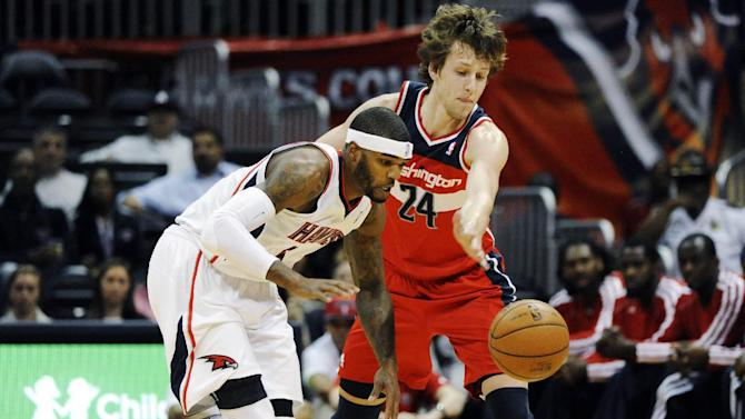 Atlanta Hawks' Josh Smith (5) steals the ball from Washington Wizards' Jan Vesely in the first half of an NBA basketball game at Philips Arena in Atlanta, Wednesday, Nov. 21, 2012. (AP Photo/David Tulis)