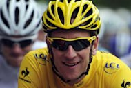 British Bradley Wiggins rides in twelfth stage of the 2012 Tour de France cycling race. Wiggins finished nearly eight minutes behind a leading group of five to retain his race lead after the 226 km 12th stage between Saint-Jean-De-Maurienne and Annonay in the Ardeche