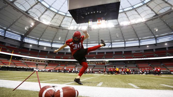 Calgary Stampeders Paredes kicks a field goal during their team's practice at the CFL's 102nd Grey Cup week in Vancouver.