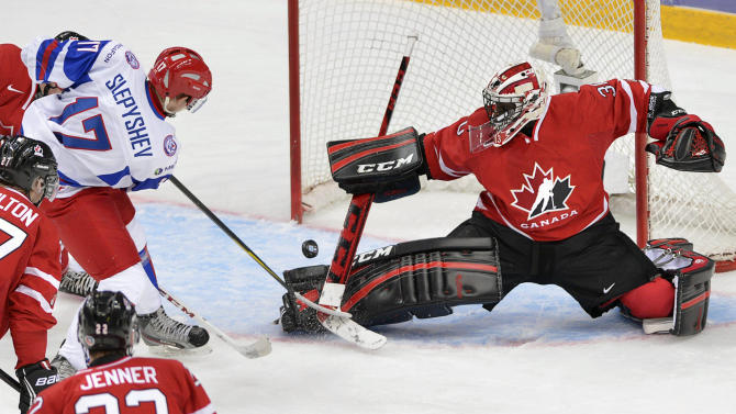 Canada goaltender Malcolm Subban makes a save off Russia's Anton Slepyshev during the first period of the bronze medal hockey game at the IIHF World Junior Championships, Saturday, Jan. 5, 2013, in Ufa, Russia. (AP Photo/The Canadian Press, Nathan Denette)