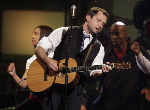 "FILE - In this April 23, 2009 file photo, Brandon Heath performs the song ""Give Me Your Eyes"" at the Dove awards in Nashville, Tenn. Christian singer Brandon Heath doesn't need to win a Grammy on Sunday to thank his biggest supporter publicly. The 33-year old Heath is taking his former high school choir teacher, Bobby Jean Frost. Heath is up for three awards, including best contemporary Christian album for ""Leaving Eden"" and contemporary Christian song and performance for ""Your Love."" (AP Photo/Mark Humphrey, File)"