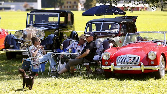 Participants enjoy a picnic during the British Car Meeting 2015 in the village of Mollis