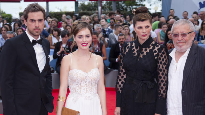 From left, actors Yiftach Klein, Hadas Yaron, Irit Sheleg, and Chaim Sharir arrive for the premiere of the movie 'Fill The Void' at the 69th edition of the Venice Film Festival in Venice, Italy, Sunday, Sept. 2, 2012. (AP Photo/Joel Ryan)