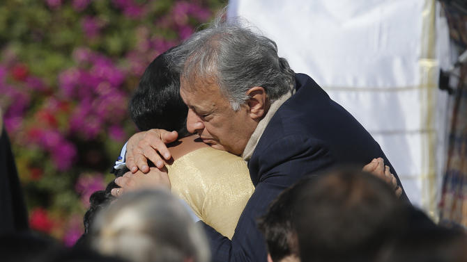 Indian Sitar maestro Ravi Shankar's wife Sukanya Rajan, left, is comforted by conductor Zubin Mehta during a memorial service for Ravi Shankar in Encinitas, Calif., Thursday, Dec. 20, 2012. Shankar was a master of the Indian sitar who collaborated with and influenced George Harrison, John Coltrane and other Western music icons. He lived in Encinitas for two decades and died last week at age 92.  (AP Photo/Jae C. Hong)   (AP Photo/Jae C. Hong)