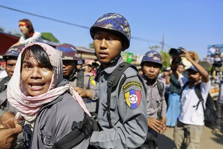 Police attempt to detain a reporter during a student protest against an education bill in Letpadan, Bago