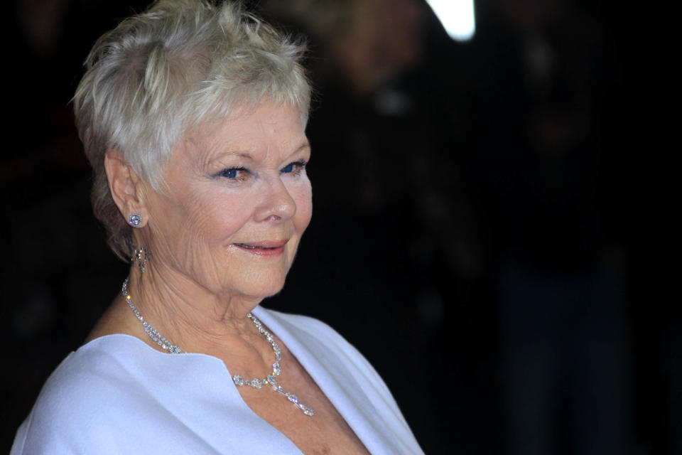 "Judi Dench arrives at the world premiere of ""Skyfall"" at the Royal Albert Hall on Tuesday, Oct. 23, 2012 in London. (Photo by Joel Ryan/Invision/AP)"