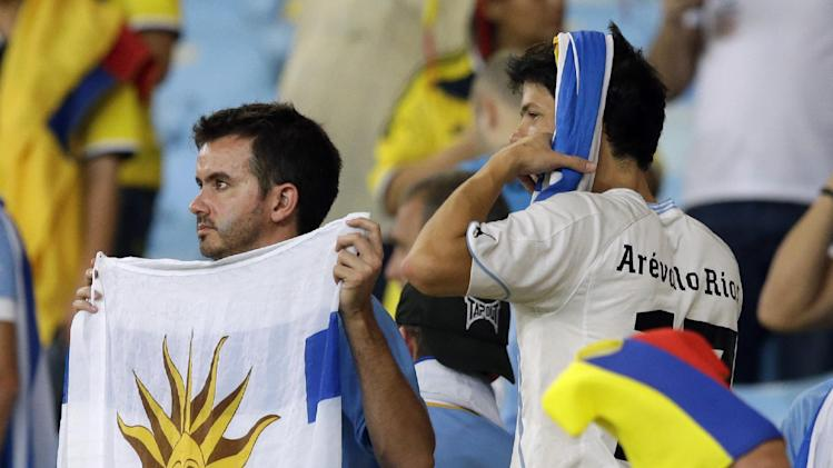 Uruguay fans react after their national teams 2-0 loss to Colombia during the World Cup round of 16 soccer match between Colombia and Uruguay at the Maracana Stadium in Rio de Janeiro, Brazil, Saturday, June 28, 2014