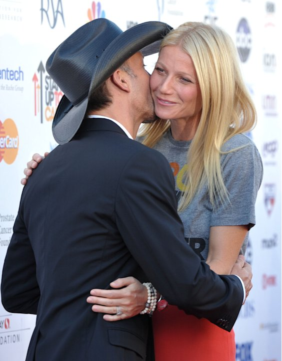 "Musician Tim McGraw, left, and actress Gwyneth Paltrow attend ""Stand Up to Cancer"" at the Shrine Auditorium on Friday, Sept. 7, 2012 in Los Angeles. The initiative aimed to raise funds to accelerate i"
