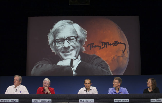 NASA scientists named the Curiosity touch-down area Bradbury Landing after writer Ray Bradbury, seen on screen, at the Jet Propulsion Laboratory in Pasadena, Calif., Wednesday, Aug. 22, 2012. The six-