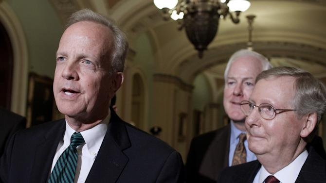 FILE - In this Nov. 14, 2012, file photo, Sen. Jerry Moran, R-Kan., incoming Chairman of the National Republican Senatorial Committee, speaks to reporters on Capitol Hill in Washington, as incoming Minority Whip, Sen. John Cornyn, R-Texas, and Minority Leader Sen. Mitch McConnell, R-Ky., listen. Moran hasn't officially taken over as chairman of the National Republican Senatorial Committee yet, but he already finds himself defending a potential nominee who's widely popular in her state while trying to avoid alienating influential players on the party's right flank. (AP Photo/Harry Hamburg, File)