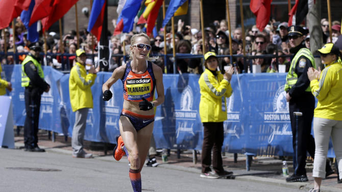 FILE - In this April 15, 2013, file photo, Shalane Flanagan approaches the finish line to finish fourth in the women's division of the Boston Marathon in Boston. Flanagan is more determined than ever to win the race for her battered hometown. The Marblehead, Mass., native would be the first American winner since 1985. (AP Photo/Elise Amendola, File)