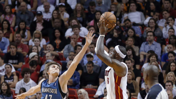Miami Heat's LeBron James (6) shoots over Minnesota Timberwolves' Andrei Kirilenko (47) during the first half of an NBA basketball game Tuesday, Dec 18, 2012, in Miami. (AP Photo/Alan Diaz)