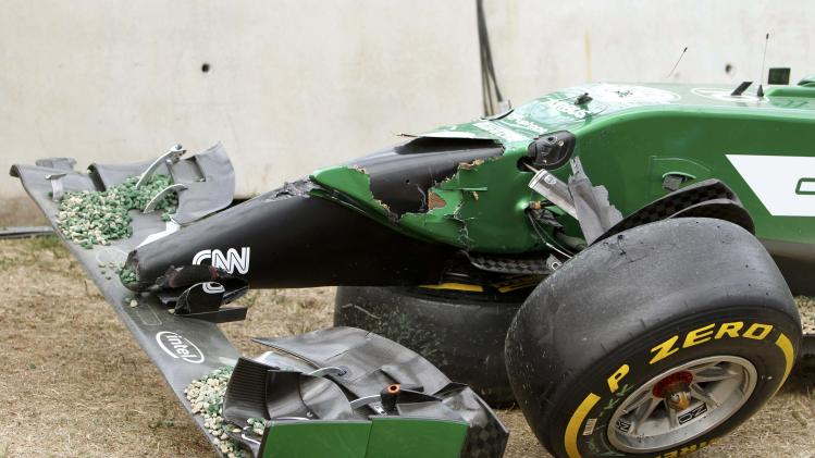 The damage to the car of Caterham Formula One driver Kobayashi of Japan is seen during the Australian F1 Grand Prix in Melbourne