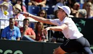 USA's Sam Querrey returns a ball to Spain's David Ferrer during the first Davis Cup semi-final match at the Hermanos Castro park court, in Gijon, Northern Spain. Ferrer won 4-6, 6-2,6-2, 6-4