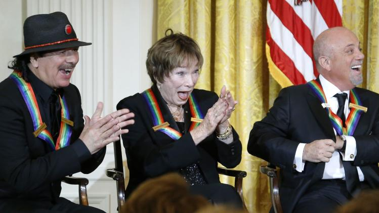 Santana and fellow 2013 Kennedy Center Honors recipients MacLaine and Joel laugh at a joke by U.S. President Obama during a reception at the White House in Washington