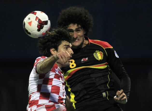 Belgium's Fellaini and Croatia's Corluka jump for a ball during their 2014 World Cup qualifying soccer match at Maksimir stadium in Zagreb