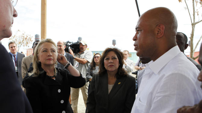 Secretary of State Hillary Rodham Clinton receives a tour of the Caracol Ekam Housing Site in Caracol Haiti, Monday, Oct. 22, 2012. From left are: Sen. Pat Leahy, D-Vt., Clinton, U.S. Labor Hilda Solis and Haitian President Michel Martelly. Clinton, and husband, former President Bill Clinton, arrived in northern Haiti Monday leading a delegation of foreign investors and a crowd of celebrities to showcase the centerpiece of the U.S. effort to help the country recover from the 2010 earthquake.  (AP Photo/Larry Downing, Pool)
