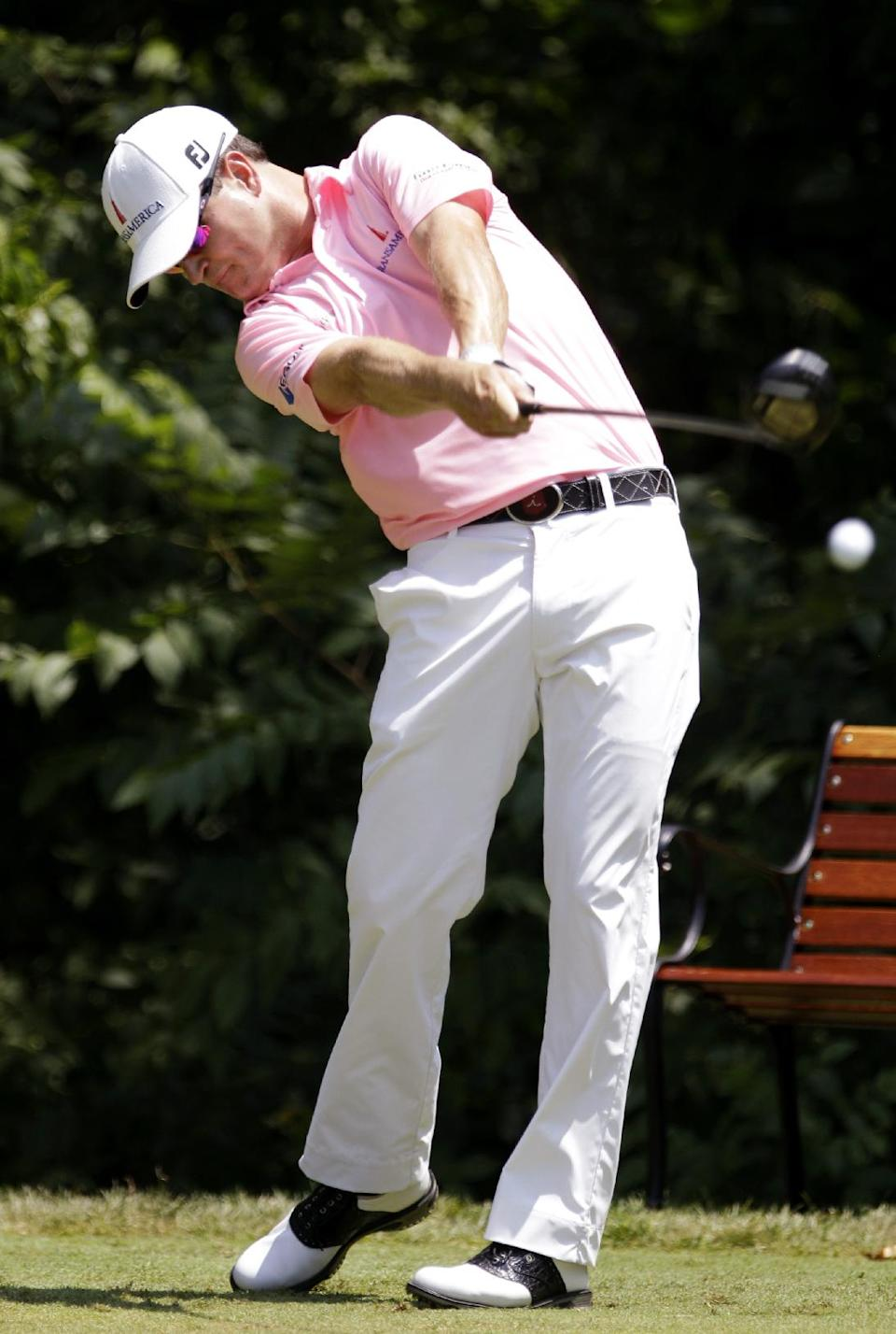 Zach Johnson hits off the second tee during the final round of the John Deere Classic golf tournament at TPC Deere Run, Sunday, July 15, 2012, in Silvis, Ill. (AP Photo/Charlie Neibergall)