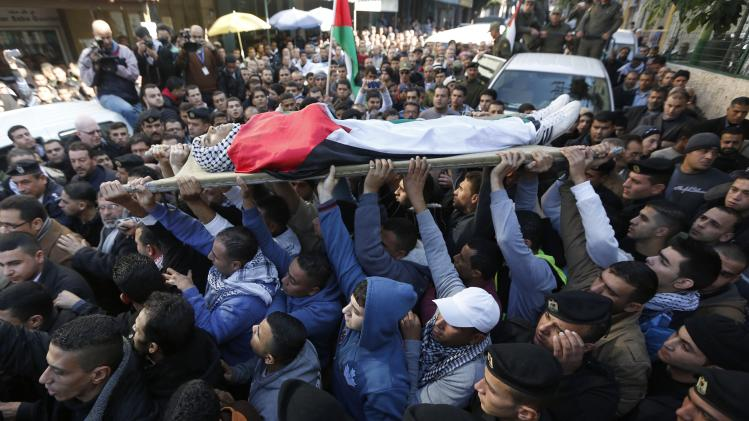 Palestinians carry the body of Saleh Yassin during his funeral in Qalqilya