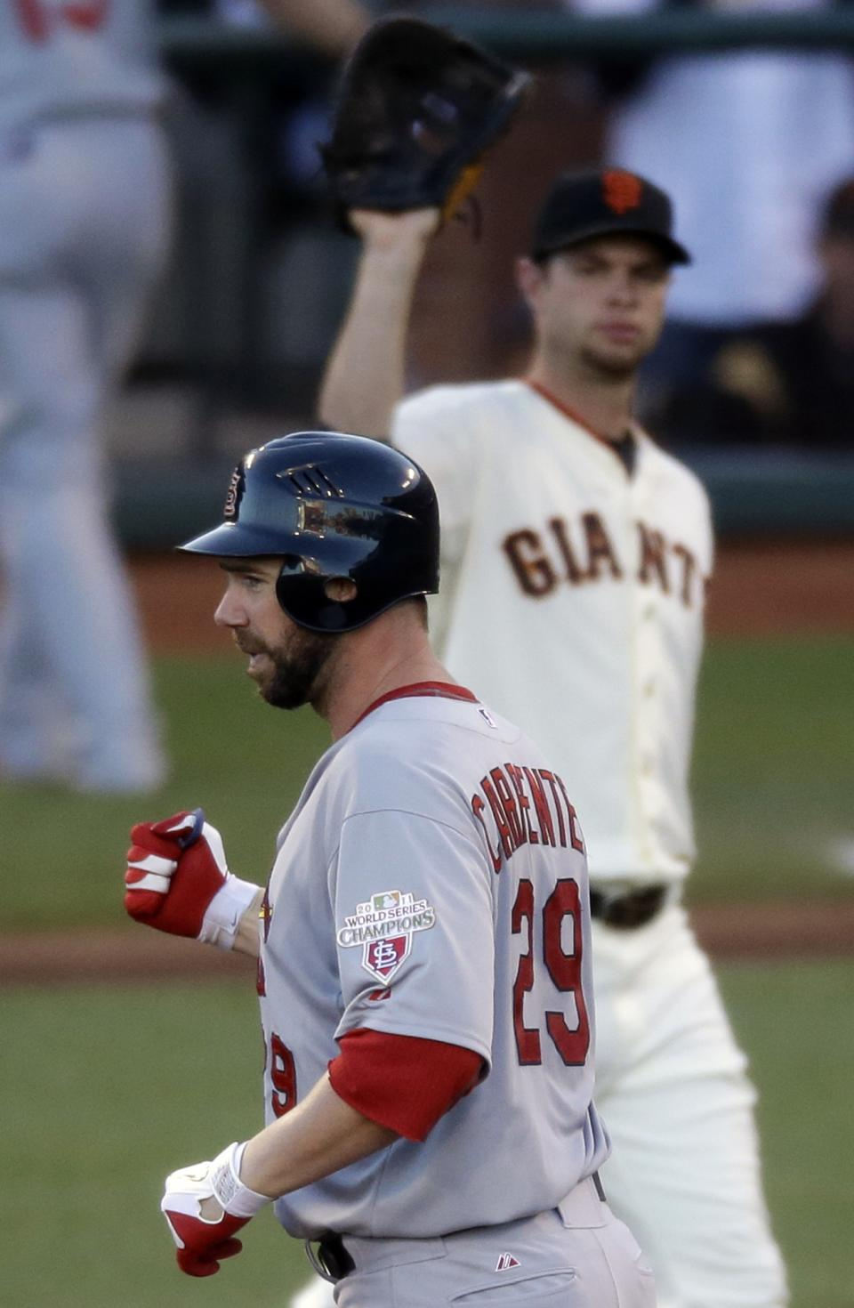 St. Louis Cardinals' Chris Carpenter reacts after hitting an RBI double during the second inning of Game 2 of baseball's National League championship series against the San Francisco Giants Monday, Oct. 15, 2012, in San Francisco. (AP Photo/Mark Humphrey)