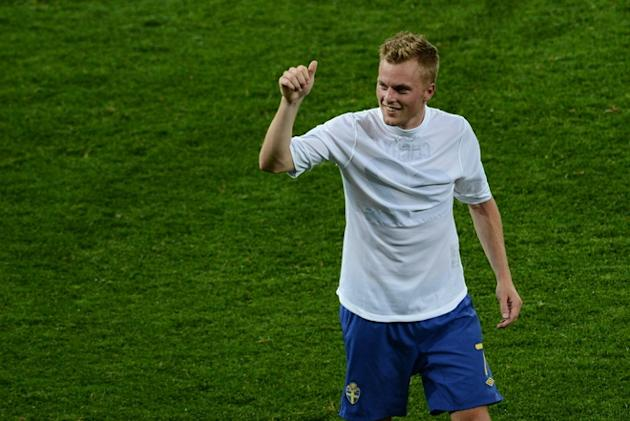 Swedish Midfielder Sebastian Larsson Celebrates  AFP/Getty Images