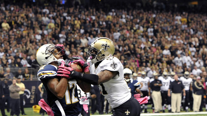 San Diego Chargers wide receiver Robert Meachem (12) catches a touchdown pass over New Orleans Saints free safety Malcolm Jenkins (27) in the first half of an NFL football game at the Mercedes-Benz Superdome in New Orleans, Sunday, Oct. 7, 2012. (AP Photo/Bill Feig)